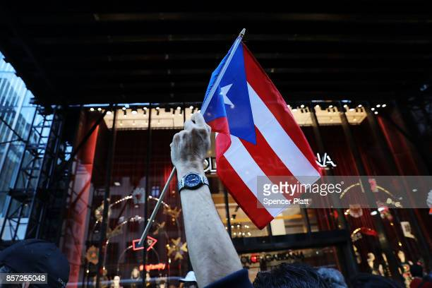 People rally outside of Trump Tower in support of Puerto Rico on the day that President Donald Trump visited the island parts of which were...