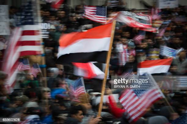 TOPSHOT People rally with flags at Brooklyn Borough Hall as Yemeni bodega and grocerystores shut down to protest US President Donald Trump's...