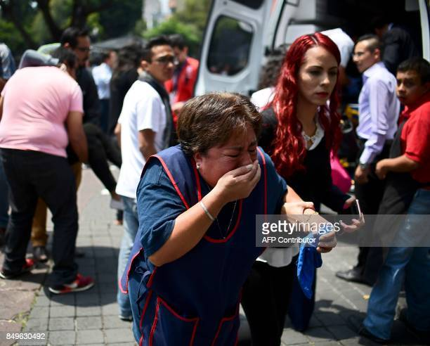 TOPSHOT People react after a real quake rattled Mexico City on September 19 2017 moments after an earthquake drill was held in the capital A 71...