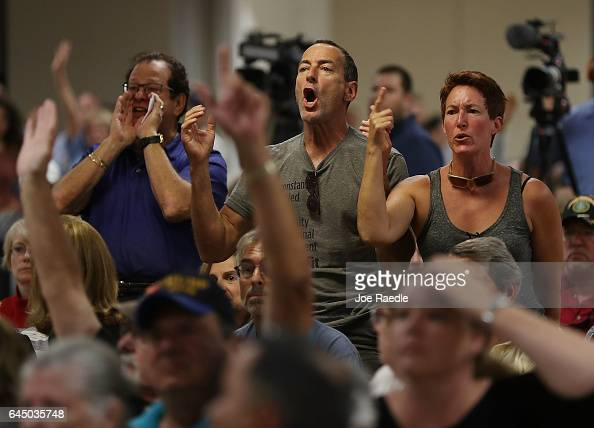 People react as Rep Brian Mast speaks during a town hall meeting at the Havert L Fenn Center on February 24 2017 in Fort Pierce Florida Rep Mast held...