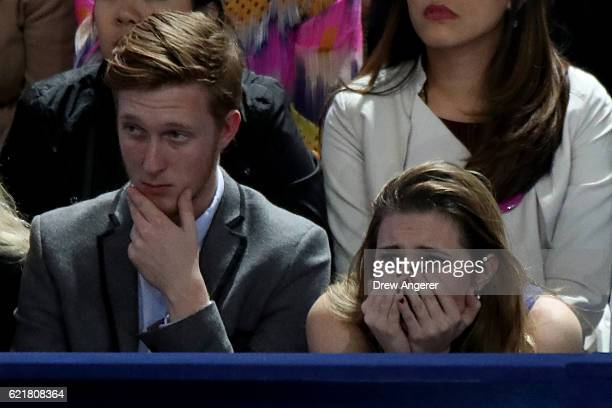 People react as they watch voting results at Democratic presidential nominee former Secretary of State Hillary Clinton's election night event at the...