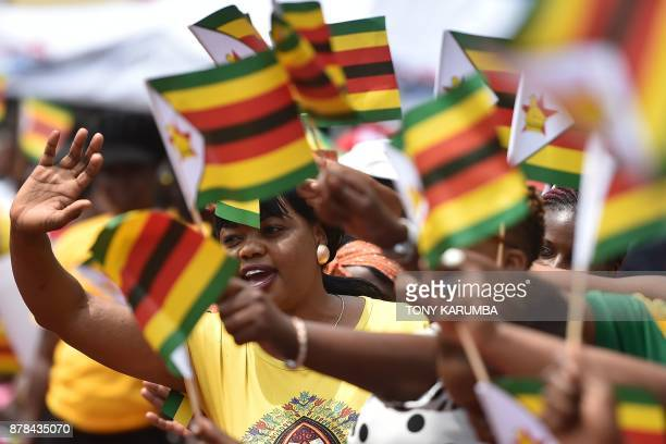 People react as Zimbabwean new President Emmerson Mnangagwa is officially swornin during a ceremony in Harare on November 24 2017 Emmerson Mnangagwa...