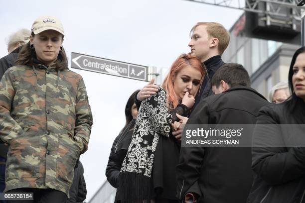 People react at the scene where a truck crashed into the Ahlens department store at Drottninggatan in central Stockholm April 7 2017 News Agency /...