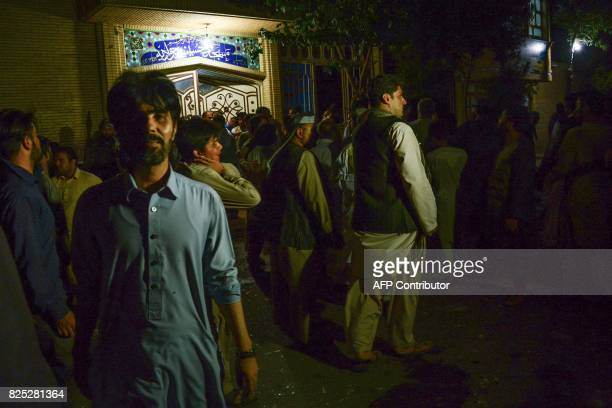 People react following a suicide bomb attack at a Shiite mosque in Herat on August 1 2017 A suicide bomber and a gunman killed more than 20 people at...