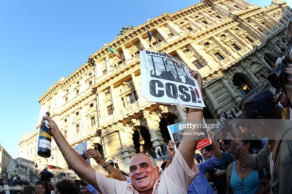 People react in front of the Justice palace to the verdict of the 'Corte di Cassazione' (Supreme Court) during the final session to judge former Italian Prime Minister Silvio Berlusconi on August 1, 2013 in Rome, Italy. The judges of the supreme court rejected Berlusconi's final appeal against the conviction for tax fraud, sentencing him to four years in prison.