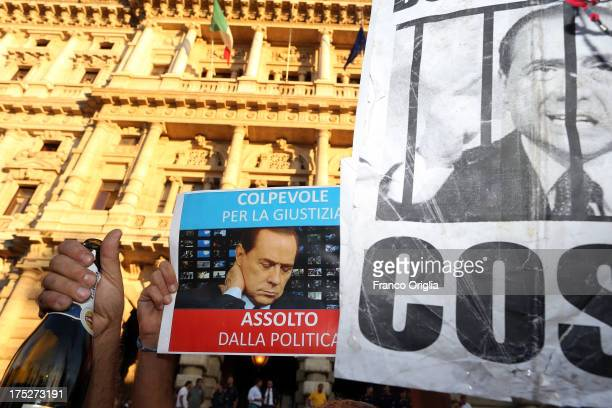 People react in front of the Justice palace to the verdict of the 'Corte di Cassazione' during the final session to judge former Italian Prime...