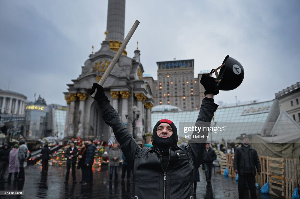 People react in Independence square following the announcement that Ukrainian President has been ousted on February 22, 2014 in Kiev, Ukraine. Ukrainian members of parliament have voted to oust Viktor Yanukovych and bring presidential elections forward to the 25th of May.