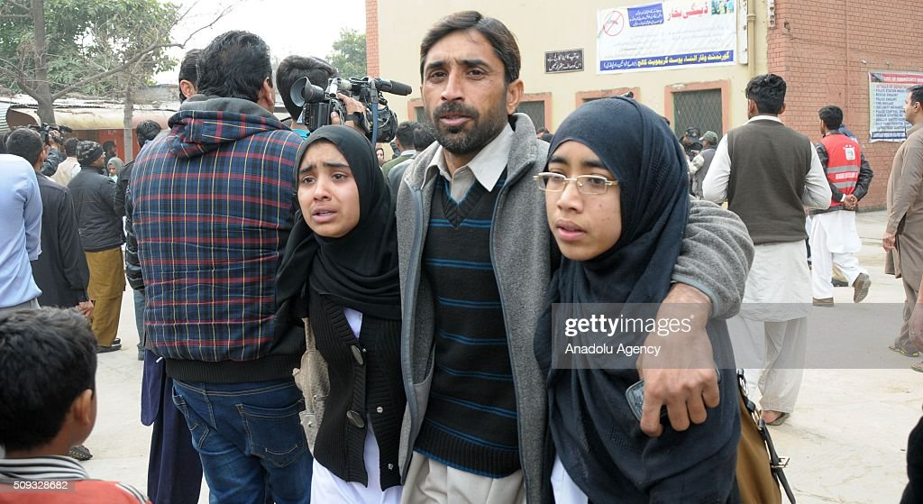 People react near the Vaqar-un-Nisa Girls College building after suspects tried to barged into the school following fire exchange between suspects and police in Rawalpindi, Pakistan on February 10, 2016. As gun shots were heard near the college, the students rushed towards the gate then caused stampede in which some students were injured.