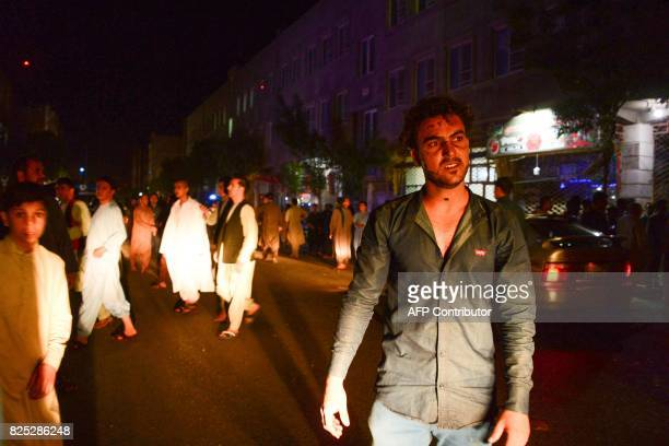 People react on the street following a suicide bomb attack at a Shiite mosque in Herat on August 1 2017 A suicide bomber and a gunman killed more...