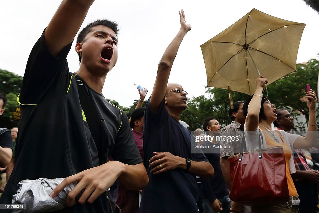 People react to a speaker speech at Hong Lim Park during the protest against the government's White Paper on Population at Speakers' Corner on February 16, 2013 in Singapore. Thousands of protesters gathered today following the release of a government white paper on population that revealed it could increase 30% to 6.9 million by 2030, angering residents who already see a strain on housing, transportation and healthcare.
