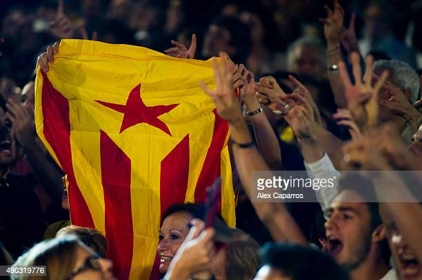 People react to the results of TV polls showing the Catalanist coalition 'Junts pel Si' could win the regional elections held in Catalonia on...