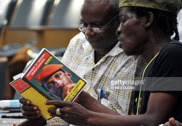 People read a book on Thomas Sankara on October 15 2017 in Ouagadougou during the 30th anniversary of the death of late Burkina Faso's leader Thirty...