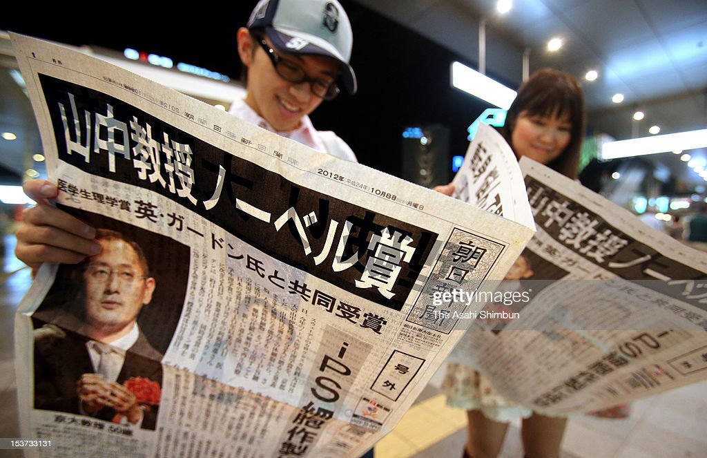 People read an extra edition of newspaper distributed to celebrate Kyoto University professor Shinya Yamanaka winning the Nobel prize at Fukuoka Station on October 8, 2012 in Fukuoka, Japan. Yamanaka and Sir John Gurdon have both been awarded the Nobel prize for medicine or physiology for their work as pioneers of stem cell research.