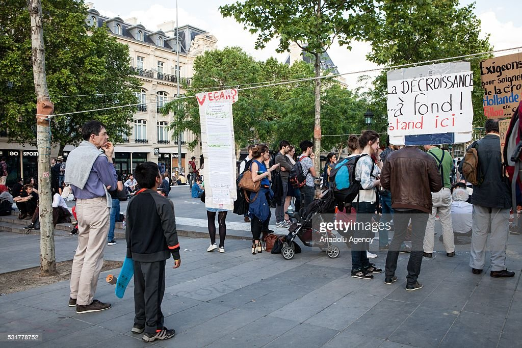 People read banners about the movement 'Nuit Debout' during the Global Debout meeting 'Nuit Debout' ('The Night awake' or Up all night') in Paris, France on May 27, 2016.