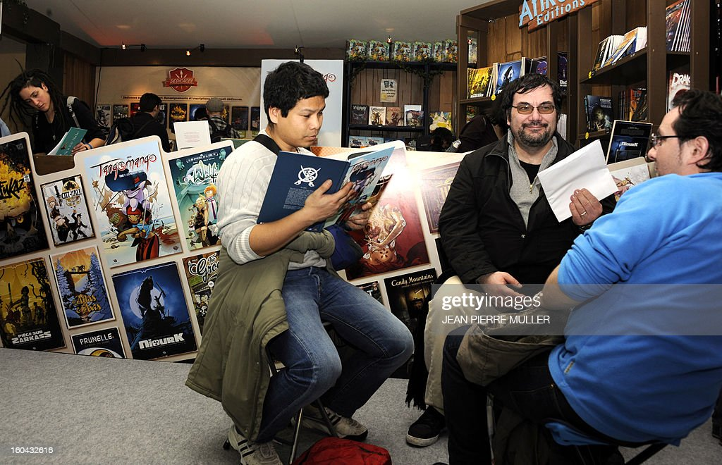 People read comic books during the Comic book festival of Angouleme on January 31, 2013 which opened today. MULLER