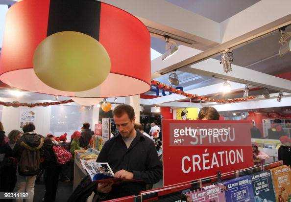 People read comic books on January 28 2010 in Angouleme western France on the opening of the 37th edition of the International comic books festival...