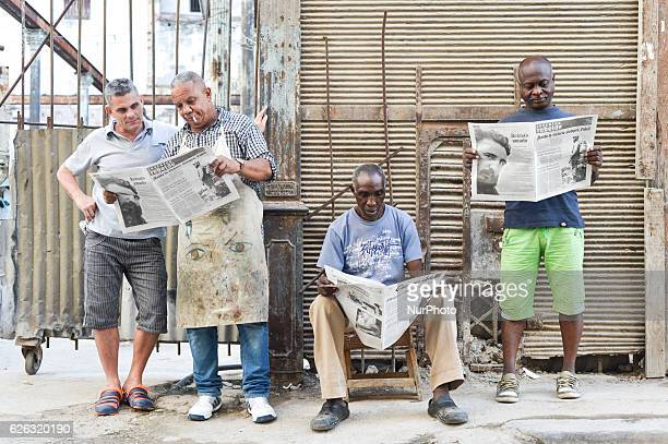 People read the latest newspapers a scene from a daily life in Havana on November 26 the next day after Fidel Castro Cuba's historic revolutionary...