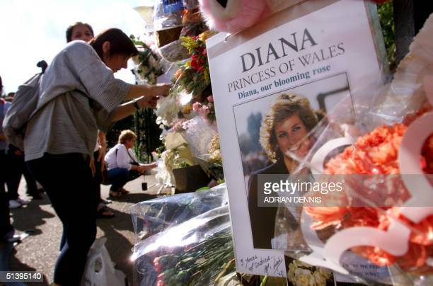 People read the tributes left around the gates of Kensington Palace Princess Diana's London residence 30 August 2000 31 August is the third...