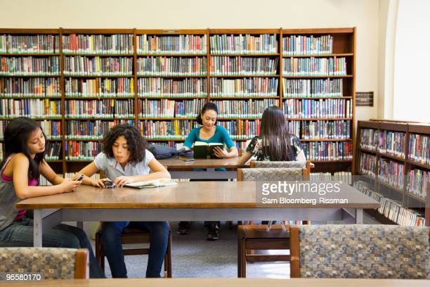 People reading books in library