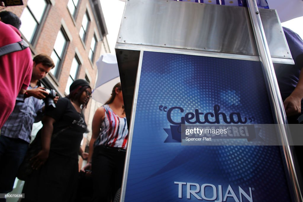 People receive a free vibrator sex toy which was being distributed by the Trojan condom company from their 'Pleasure Carts' on August 9, 2012 in New York City. The carts, which resemble traditional hot-dog carts, had to shut down during a give-away on Wednesday due to large crowds.