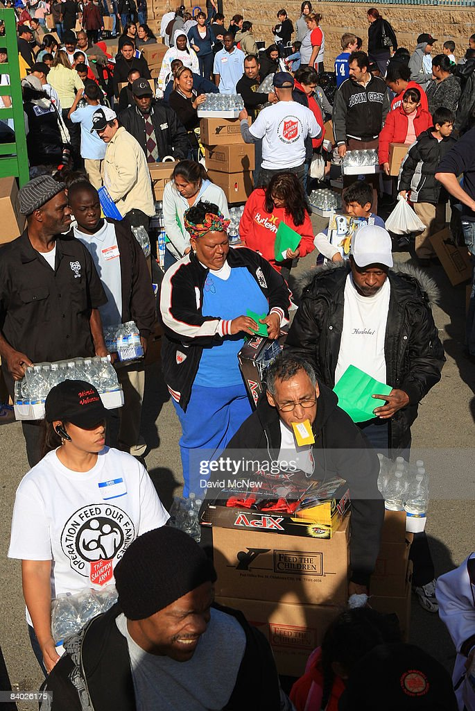 People receive gifts of food, personal care and household items and toys at the Miracle in South Central event, part of the nationwide Miracle on Main Street, USA program to help working poor and disadvantaged families on December 13, 2008 in the South Central neighborhoods of Los Angeles, California. About 5,000 families are expected to receive enough food at the event to supplement meals for a family of four for a week. Miracle on Main Street, USA is sponsored by The National Basketball Players Association (NBPA) along with Feed The Children, Feed 333, Humanity Unites Brilliance (HUB) and hosted by the Salvation Army.