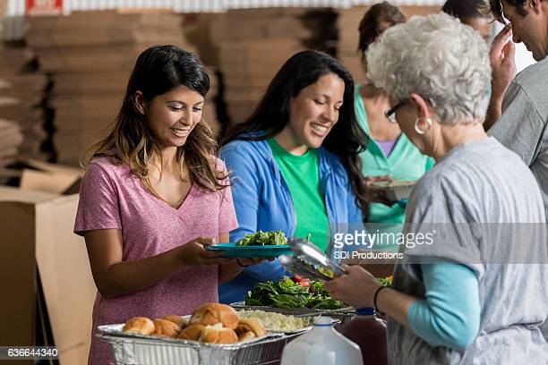 People receive healthy meals at soup kitchen