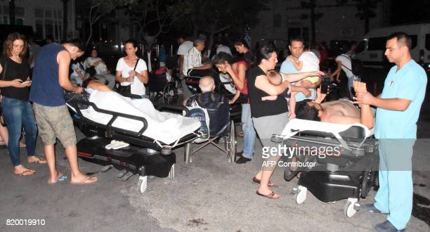 People receive medical treatment in the garden of the Bodrum State Hospital following an earthquake on July 21 2017 in Bodrum southwestern Turkey Two...