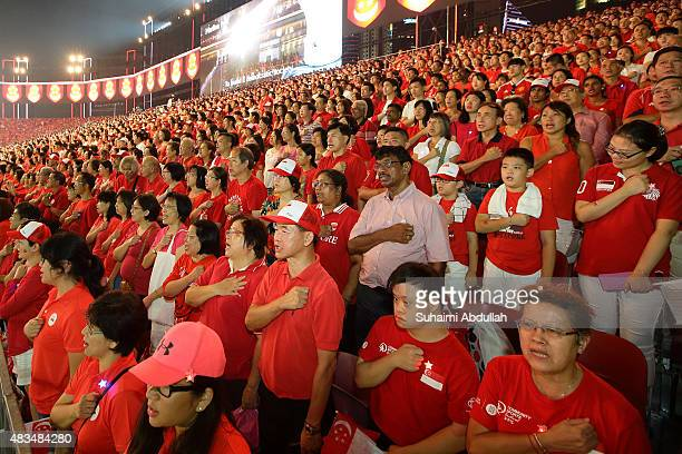 People recite the pledge at the end of the National Day Parade at Padang on August 9 2015 in Singapore Singapore is celebrating her 50th year of...