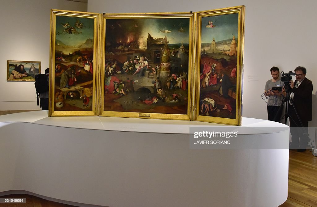 People record images of paintings by Dutch painter Jheronimus Bosch know as 'El Bosco' during the presentation of the 'The Bosco, The fifth centenary' exhibition at El Prado museum in Madrid on May 27, 2016. / AFP / JAVIER
