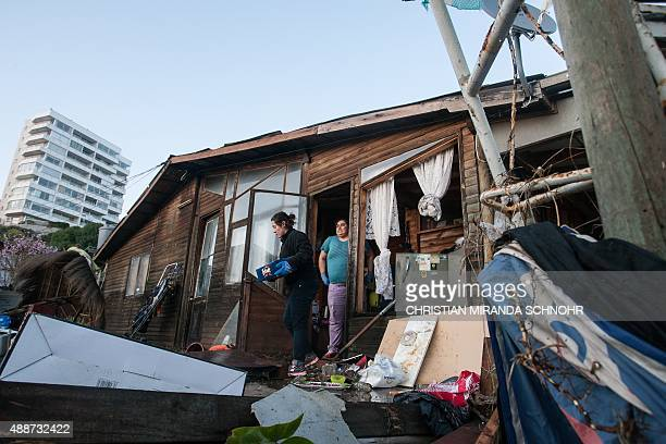 People recover their belongings in Concon some 110 km northwest Santiago after a massive earthquake on September 17 2015 Santiago Chile The...