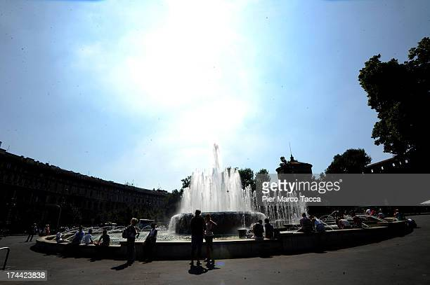 People refresh close to Castello Sforzesco fountain on July 25 2013 in Milan Italy This weekend Italy is expected to reach the highest temperature of...