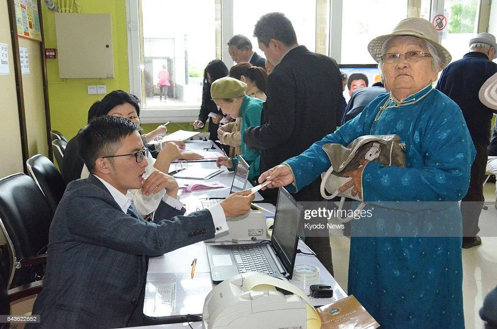 People register themselves at a polling station in Ulan Bator to vote in Mongolia's general election on June 29, 2016.
