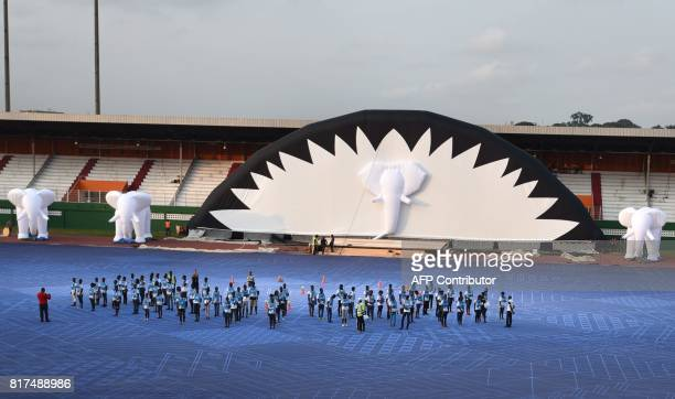 People rehearse for the opening ceremony on July 17 2017 at the Felix HouphouetBoigny stadium in Abidjan ahead of the Jeux de la Francophonie The...