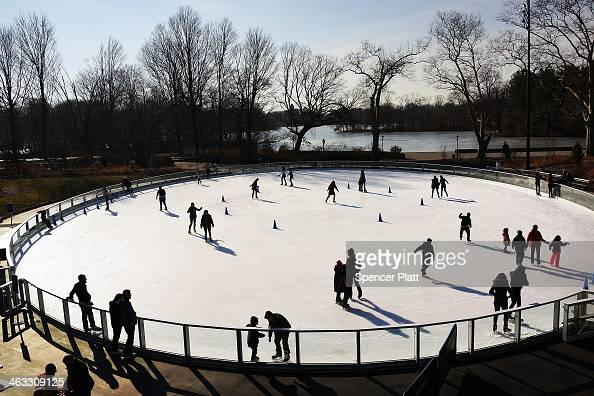 People relax at a new ice rink at the Samuel J and Ethel LeFrak Center following on a sunny winter afternoon in Prospect Park January 17 2014 in the...