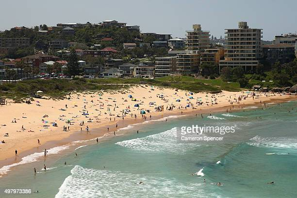 People relax at Freshwater beach on November 20 2015 in Sydney Australia The East coast of Australia has has been experiencing a heatwave with...