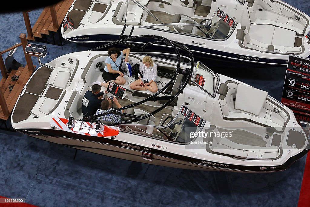 People relax in a boat on display at The Miami International Boat Show at the Miami Beach Convention Center on February 15, 2013 in Miami Beach, Florida. The boat show has more than 3,000 boats on display and more than 1,000 boating accessories, the show ends on Monday.