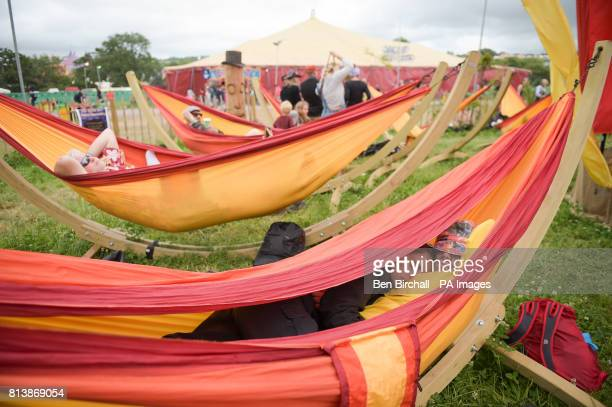 People relax in hammocks at Glastonbury Festival Worthy Farm Somerset PRESS ASSOCIATION Photo Picture date Sunday June 2017 Photo credit should read...