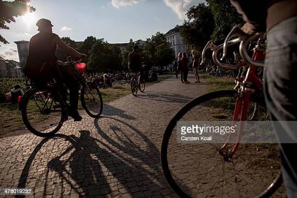 People relax in Kreuzberg district during the annual 'Fete de la Musique' music fest on June 21 2015 in Berlin Germany During 'Fete de la Musique'...