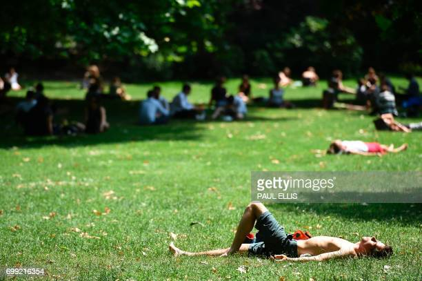 People relax in the hot weather in St James's Park in central London on June 21 2017 Europe sizzled under a continentwide heatwave on June 21 with...