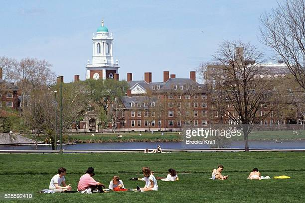 People relax in the park accross from Harvard Business School in Boston is one of the graduate schools of Harvard University and the world's leading...