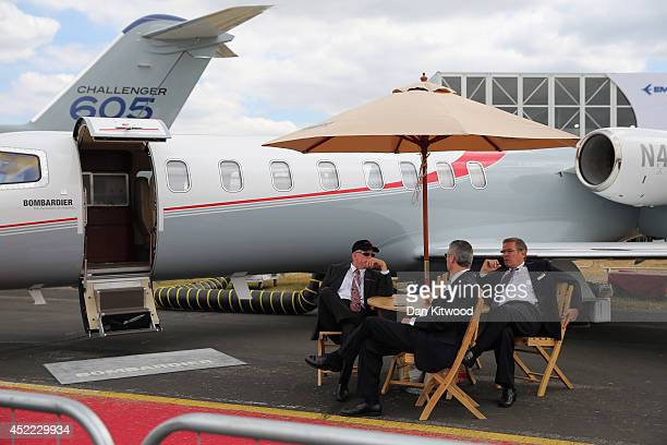 People relax on a Bombardier stand on day four of the Farnborough International Airshow on July 16 2014 in Farnborough England The Farnborough...