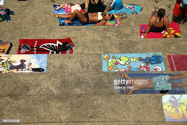 People relax on a hot afternoon at the Astoria Pool in the borough of Queens on August 17 2015 in New York City The main pool the biggest in New York...