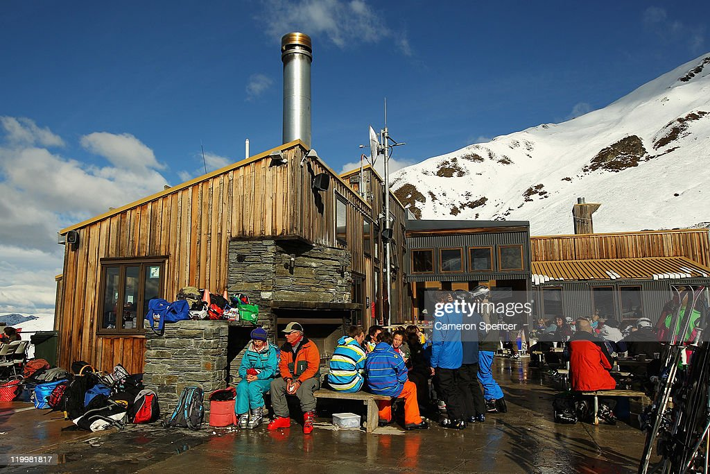 People relax on a verandah at the base lodge at Treble Cone ski resort on July 28, 2011 in Wanaka, New Zealand.