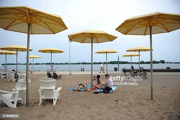 People relax on an the Urban Beach in HTO Park in Toronto Ontario on July 8 two days before the opening ceremony for the 2015 Pan American Games AFP...