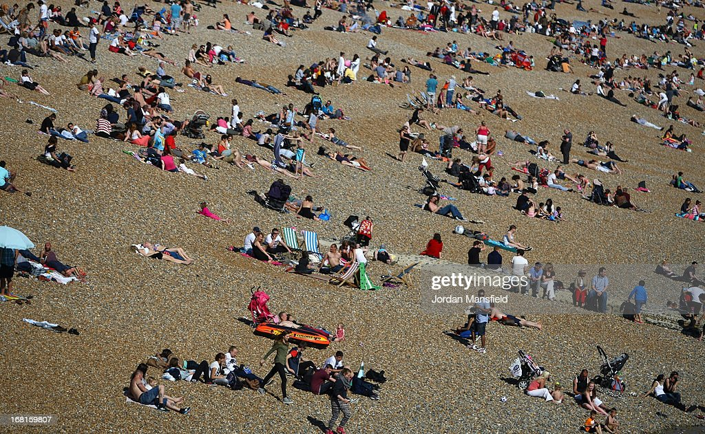 People relax on Brighton Beach on May 6, 2013 in Brighton, England. Visitors have flocked to Brighton Beach as the Met Office predicted the May Day Bank Holiday to be the hottest day of the year so far.