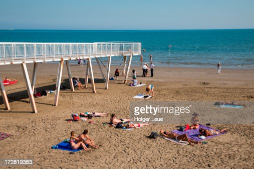 People relax on Lido beach