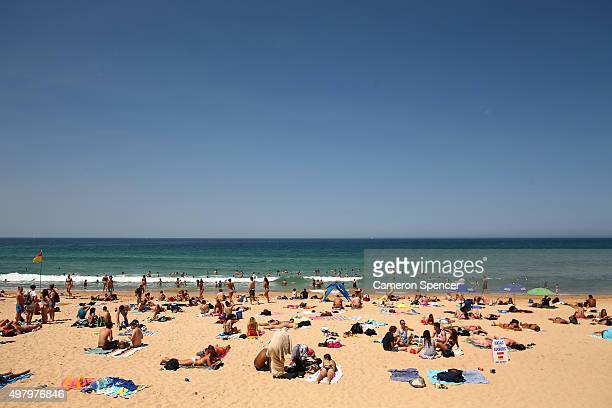 People relax on Manly beach on November 20 2015 in Sydney Australia The East coast of Australia has has been experiencing a heatwave with...