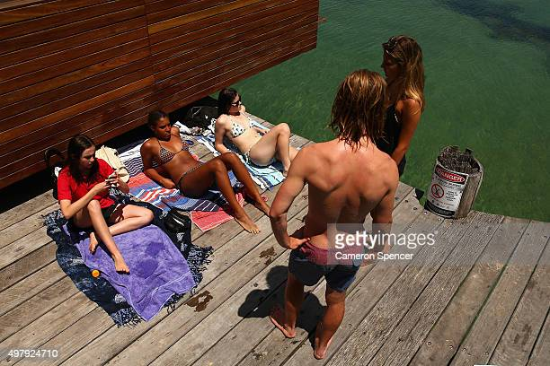 People relax on Manly wharf on November 20 2015 in Sydney Australia The East coast of Australia has has been experiencing a heatwave with...