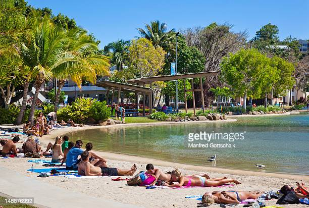 People relaxing at the Airlie Beach swimming lagoon.