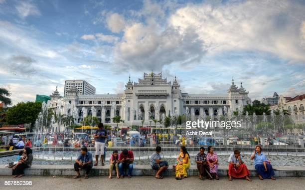 People relaxing at the Mahabandula park in downtown Yangon.